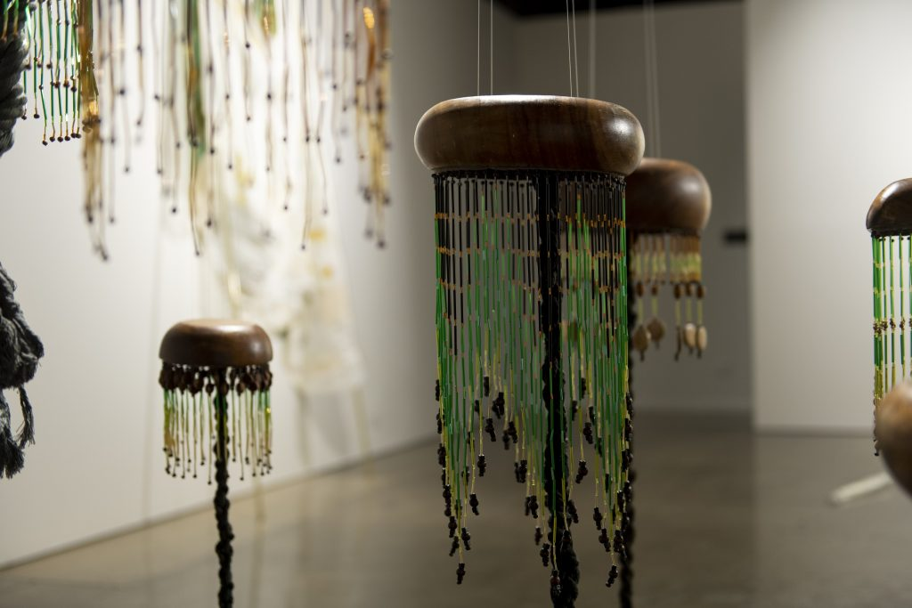 Sera Waters, '9 Son Pining (Toxic Needles)' (detail), 2017, found wooden bowls, rope, crystals, bugle beads, herringboned vinyl floor tiles. Photography by Iain Bond.