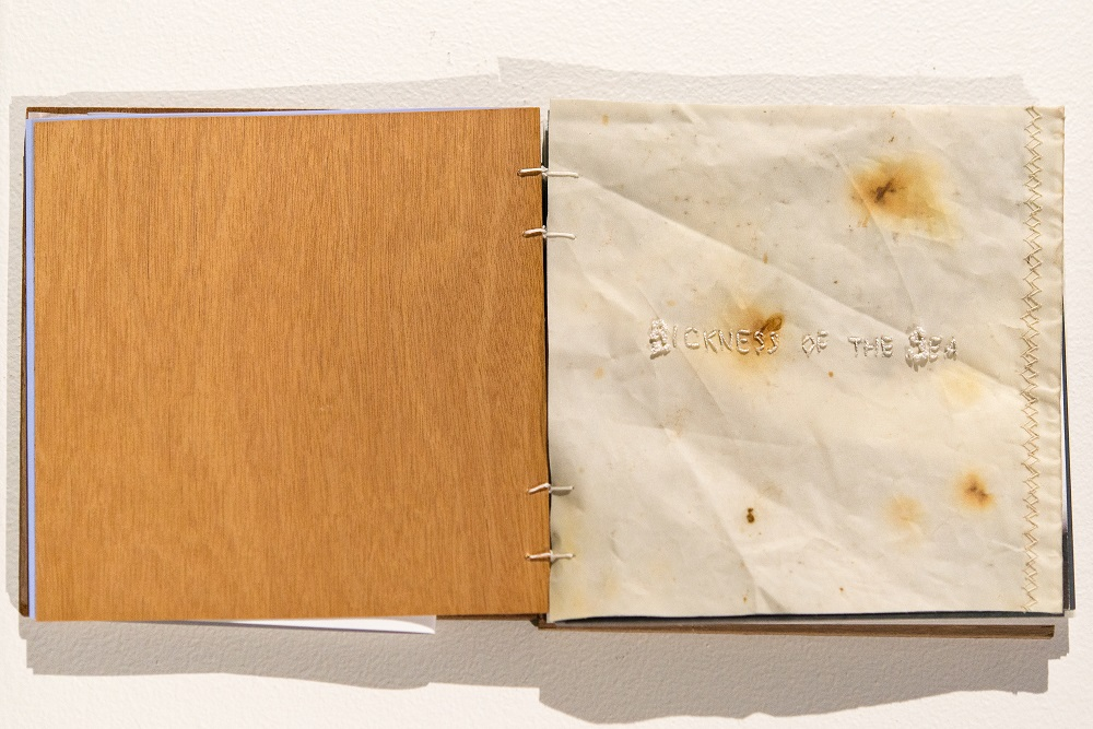 Edwina Cooper, 'Artist Book', installation view, 2020, Marine ply, marine varnish, whipping twine, various papers and inks, graphite, microwood sheet, dacron sailcloth, sailmakers thread, spinnaker cloth, acrylic sheet, salt water, Edition of 12. $180 each. Photography by Steph Fuller.
